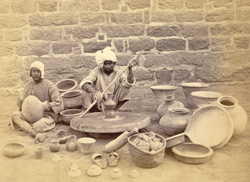 Potters at work with a stone wheel, Karachi Jail